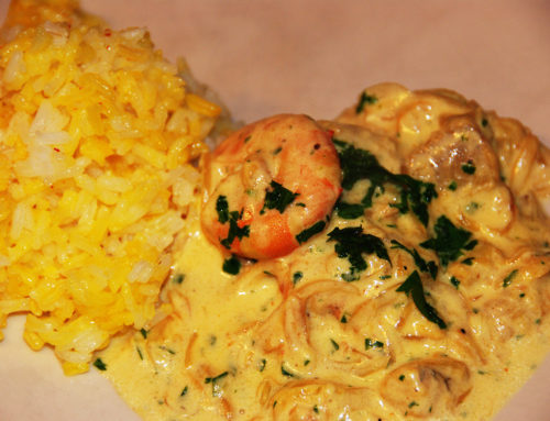 Seafood casserole with saffron rice